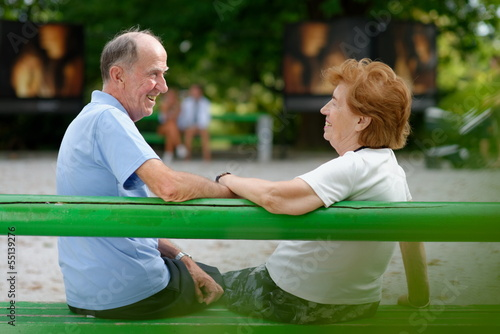 Senior couple sitting on a bench