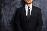 Businessman in front of blank blackboard