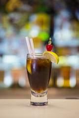 Cuba Libre cocktail on a bar