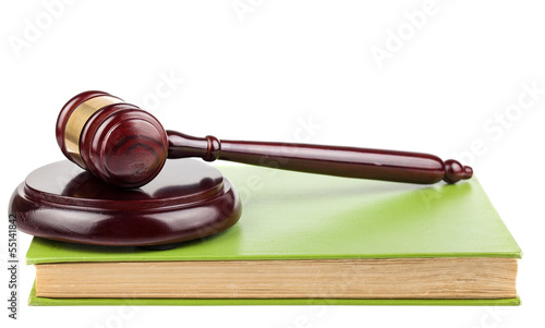 Wooden brown gavel and green book