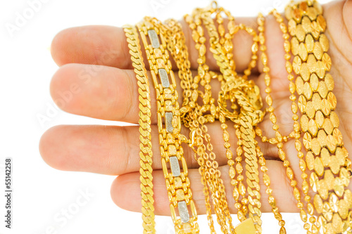 Woman hand holding gold chains