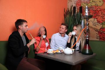 people smoking hookah