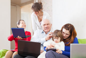 multigeneration family uses few portable electronic  devices