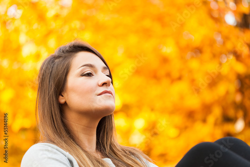 Woman relaxing in autumn