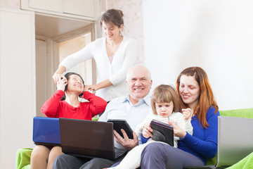 happy  family using few portable computers