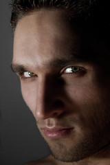 Portrait of sexy dark man posing in studio