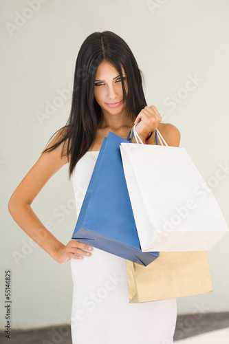 Posh brunette shopper.