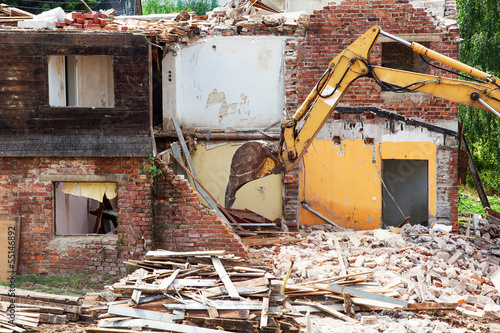 canvas print picture House demolition with excavator