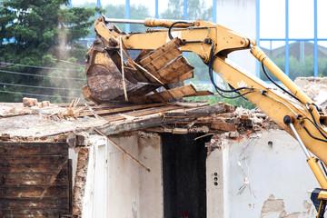 House demolition with excavator