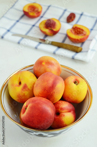 Ripe nectarines in oriental bowl