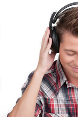 Man in headphones. Cropped image of handsome young man in headph