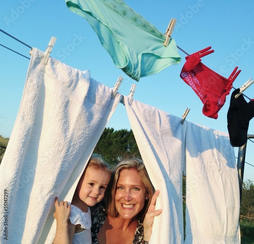 young girl hanging linen