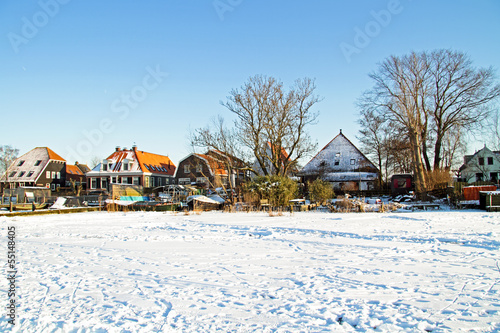 Snowy traditional dutch houses in the Netherlands