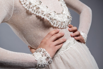 Detail of white knitted dress
