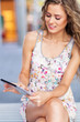 Attractive woman with digital tablet