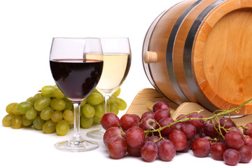 Grape on the barrel, glasses of wine
