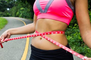 Waist measurement on a fit woman