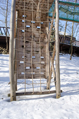 rope climb wooden construction snow winter