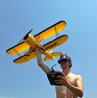 man playing with rc airplane