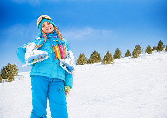 Smiling girl with ice-skates