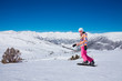Young snowboard woman in pink