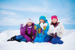 Three lovely girls with heart made of snow