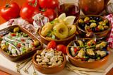 Fototapety Spanish Cuisine. Assorted tapas on ceramic plates.