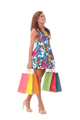 happy girl is walking with shopping bags