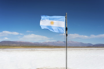 Flag on the Salinas Grandes in Jujuy, Argentina.