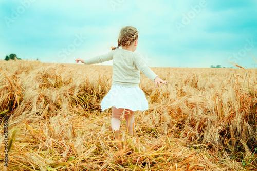 happy child dancing field