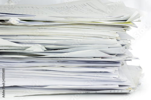 Piled up office work papers