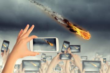 People taking photo of meteorite