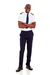 african airline captain with arms crossed