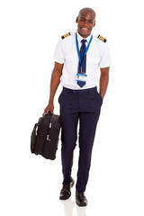 young airline pilot carrying briefcase
