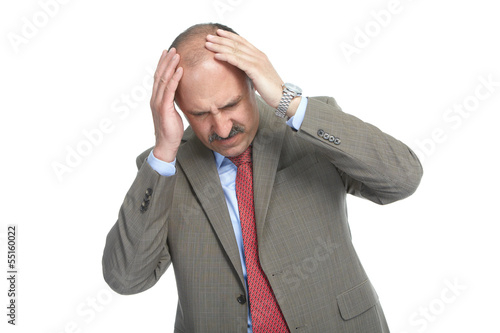 The headache. Businessman on a white background