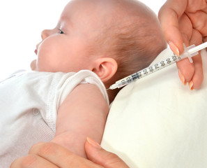 Doctors hand with syringe vaccinating child baby flu
