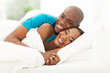 happy african couple in bed
