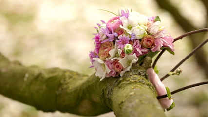 Bridal bouquet in tree during wedding