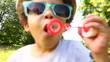 Little african american boy blowing bubbles in slow motion