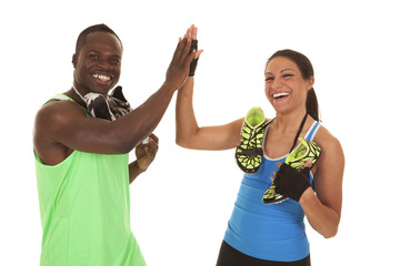 fitness man woman with shoes high five