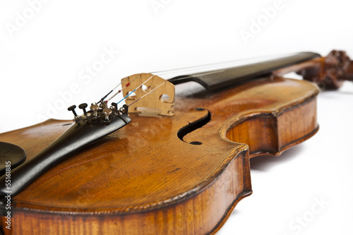 Old violin on a white background