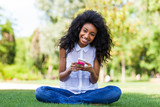 Teenage black girl using a phone - African p