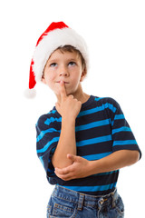 Thoughtful boy in Santa hat