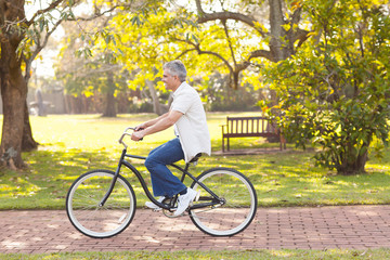 mid age man riding bicycle