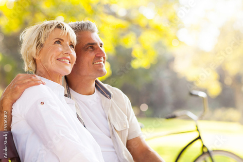 elegant mature couple sitting outdoors