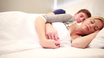 Young Couple sleeping in bed, eyes closed