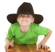 Boy green shirt cowboy hat lay looking