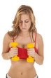 Woman red sports bra yellow weights by chest