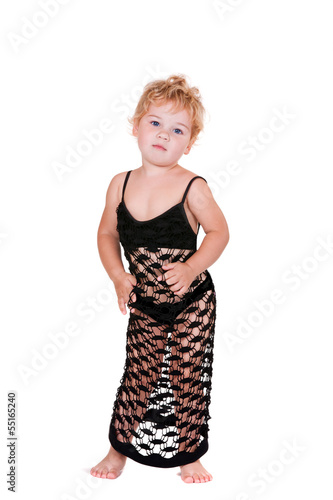 Beautiful year-old girl in a dress for adults