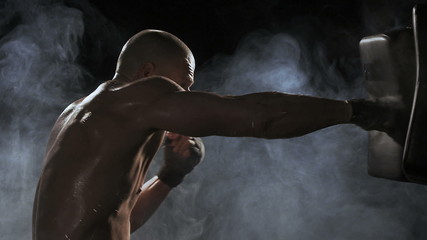 Kickboxer shadow boxing as exercise for the big fight